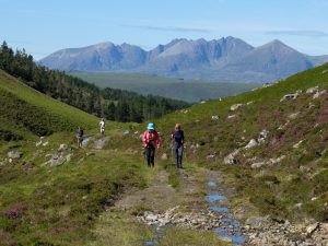 2 ladies walking along Cape Wrath Trail on a clear day