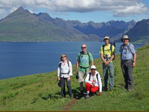 Group on the Skye Trail with the Cuillin Ridge in the Background