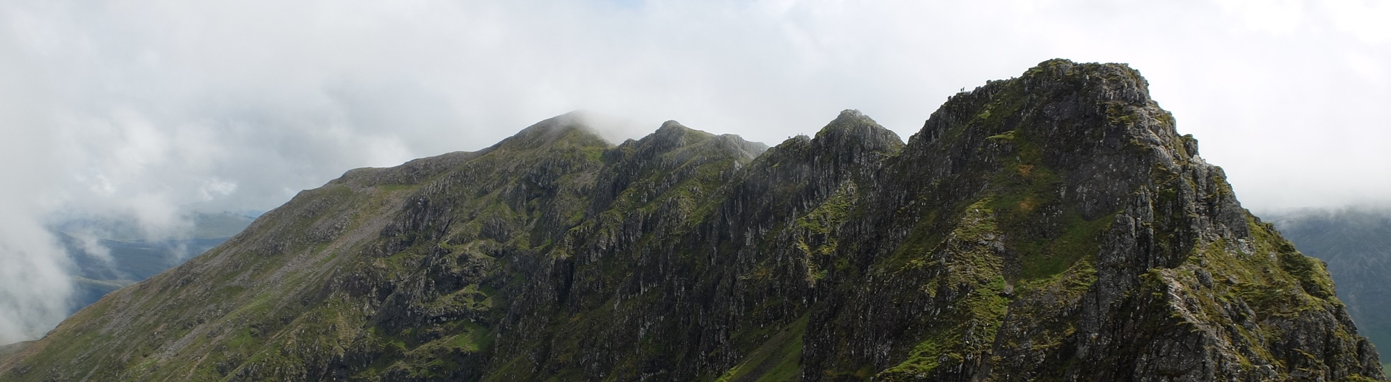 The Aonach Eagach Ridge with a patch of cloud