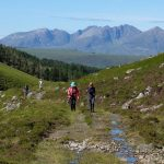 Customers walking along a track on The Cape Wrath