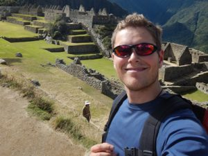Photo of Chris with Inca ruins behind him.