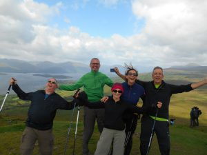 Group looking very happy with Loch Lomond in the background.