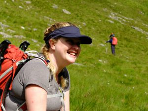 Lady smiling on a sunny day on The Cape Wrath Trail