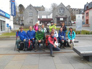 Group at the finish of the West Highland Way in Fort William with the guide Tom