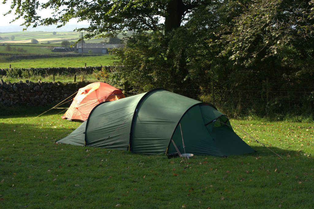 Large Green Tent pitched on a campsite