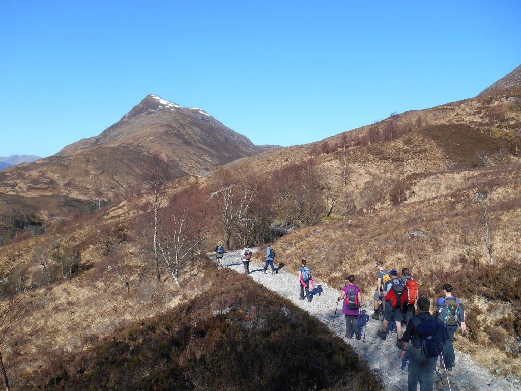 Group of customers walking along Larig Mor on the West highland Way