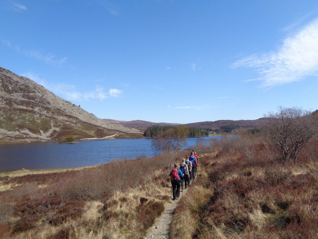 Group walking along the Loch Gynack on The East Highland Way