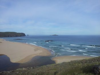 Sandwood Bay on the Cape Wrath Trail with small rolling waves