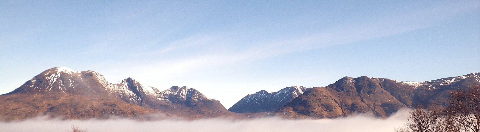 View of The Torridon Giants on a beautiful day with a cloud inversion