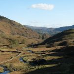 A Dry stone Wall and River twisting through the Lake District