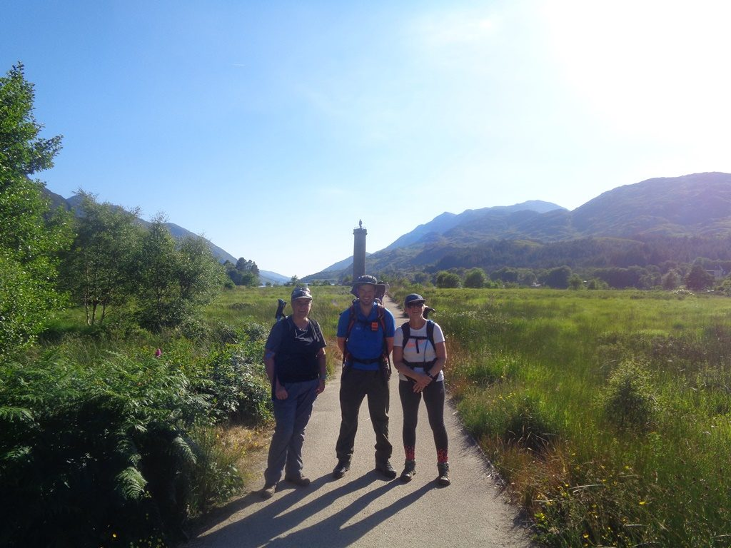 Customers in front of Glenfinnan Monument - Wilderness Weekend