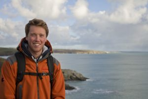Picture of Dan Burke Thomson on a coastal path.