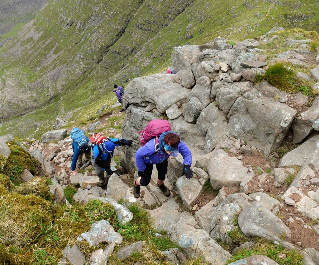 Photo of the group scrambling on the horns of alligin
