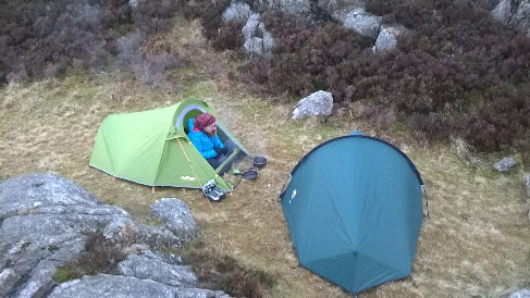 The perfect campsite: flat, tucked away and the tents blend in.